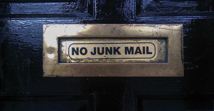 no junk mail sign on a door